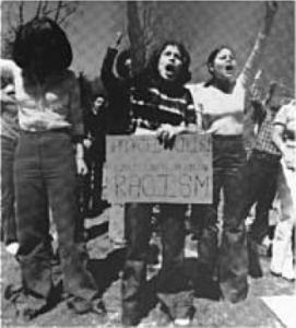 The Princeton Alumni Weekly identifies the woman on the right as Marta Rita Velázquez as a student on 18 March 1977.